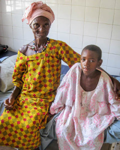 Ali Kabia, 9, with his grandmother, recovering from  hernia surgery at Holy Spirit Hospital - January 2014.